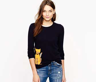 woman wearing a cat sweater
