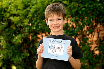 Evan Moss Holding His Seizure Dog Book