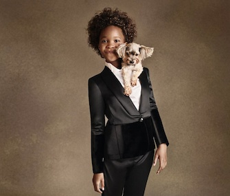 Actress Quvenzhané Wallis poses with a dog for Armani Junior.