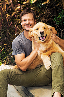 Bailey Chase with his dog, Blue