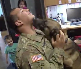 Spc. Andrew Brown gets smothered with kisses from his K9 partner, Rocky.