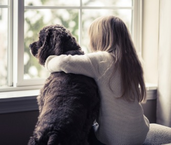 Girl with arm around dog