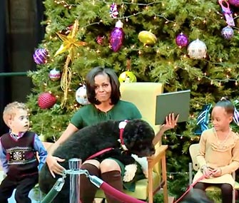 Bo Obama climbs into his mom's lap for story time.