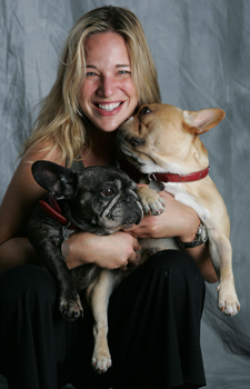 Patty Khuly holding two dogs