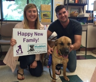 This couple adopted a dog from a Wisconsin shelter during Maddie's Pet Adoption Days.