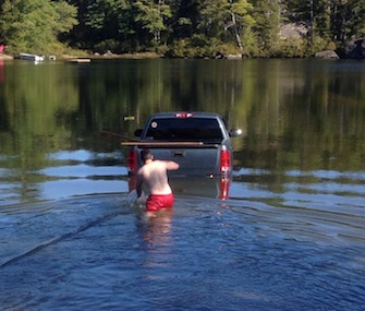 dog rescued from truck in lake