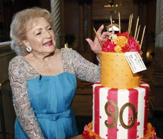Betty White with her 90th birthday cake