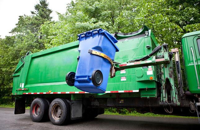 Dog hates garbage truck