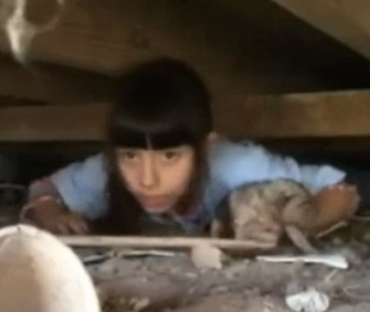 Nina Boyett, 7, crawled under an old barn to rescue a 10-day-old puppy.