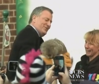 New York Mayor Bill de Blasio holds the Staten Island Zoo's groundhog Charlotte on Groundhog's Day.