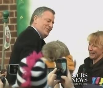 New York Mayor Bill de Blasio holds the Staten Island Zoo's groundhog Charlotte on Groundhog's Day.