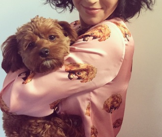 Singer Katy Perry showed off her custom pajamas — and her puppy — on Instragram.