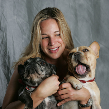 Patty Khuly Holding Two French Bulldogs