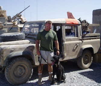Remmy poses with Army Sgt. Dan Traeder during their time together in Afghanistan in 2004.