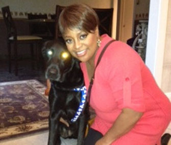 Sherri Shepherd poses with her rescued Lab.