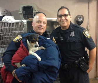 Officers Paul Garcia and Allen Speed set up a roadblock to save a stray dog on a busy highway in Fort Worth, Texas.