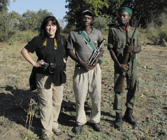 photographer in Africa with armed security
