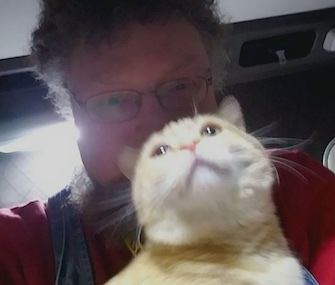 Truck driver Paul Robertson was reunited with his cat, Percy, after the cat survived 400 miles riding under the semi truck.