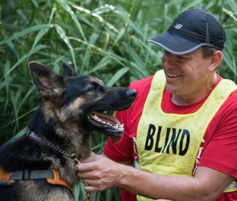 Klinger, a German Shepherd, was trained to be a running guide dog for Richard Hunter, who's blind.