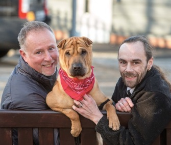 Kai sits with his new owner, Ian Russell, left, and the Scottish SPCA's Alan Grant.
