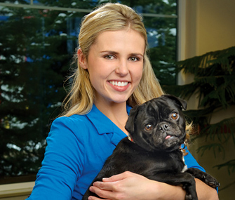 Dog trainer Mikkel Becker and her dog Willy