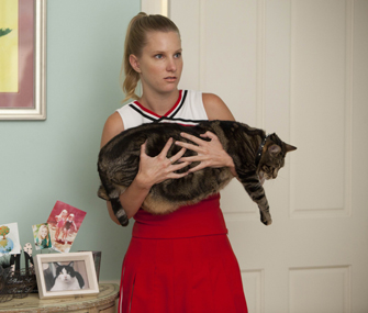 Brittany from Glee holding Lord Tubbington