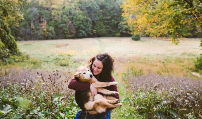 Maria Sharp holds Chubby just as she did when she was a child and the dog was a puppy.