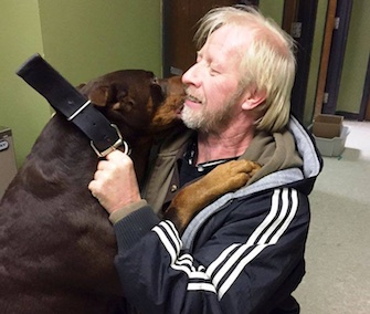 Titan smothers his original owner, Allen Williams, with kisses at their reunion Saturday.