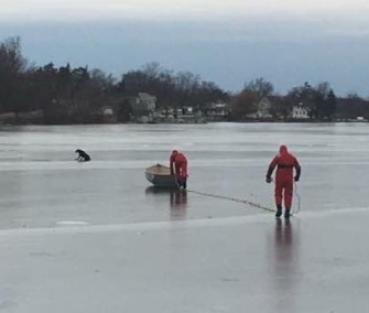 Firefighters helped a 14-year-old Lab off icy Lake Orion in Michigan on New Year's Eve.