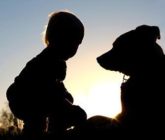 young child and dog silhouette