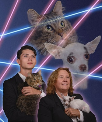 Draven Rodriguez and feline Mr. Bigglesworth pose with Principal Diane Wilkinson and her dog, Vivian.
