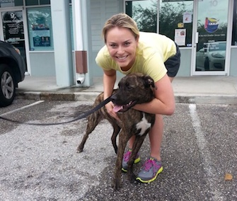 Lindsey Vonn poses with her puppy outside the animal shelter where she adopted him.