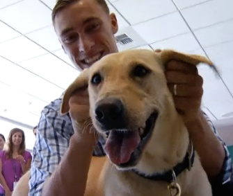 Marine Sgt. Sam Wettstein was reunited with his canine partner Belle Sunday.