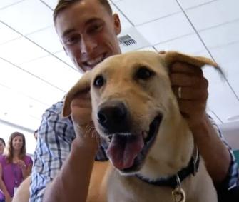 Marine Sgt. Sam Wettstein was reunited with his canine partner Belle Sunday.