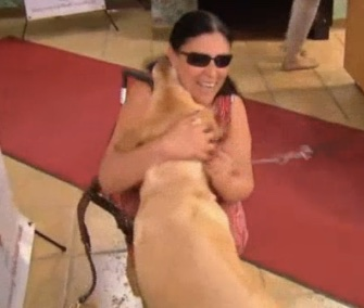 Maria Colon is reunited with her service dog, Yolanda, after a fire in their home.