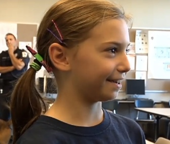 Allison Henry, 10, raised nearly $1,000 to get a bulletproof vest for K9 officer Ryker.
