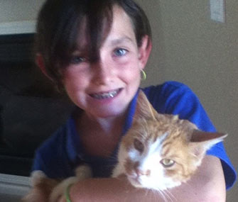 Carlie Sheridan is reunited with her cat, Splash.