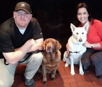 Kristen Maurer, right with her dog Roxie, helped reunite Army veteran Jason Bos with his military working dog, Cila.