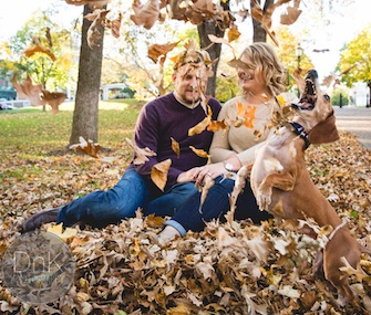 Louie the Dachshund photobombs an engagement photo shoot of his owners, Megan Determan and Chris Kluthe.