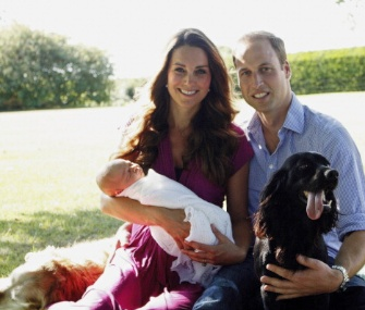 The Duchess of Cambridge and Prince William are pictured with their baby boy, Prince George, and dogs Tilly, left, and Lupo, right.