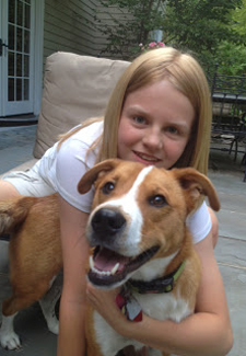 Girl and rescued dog.