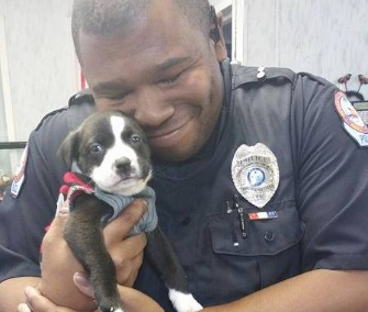Police Officer Marcus Montgomery fell in love with an adorable puppy he met at a shelter while on a call.