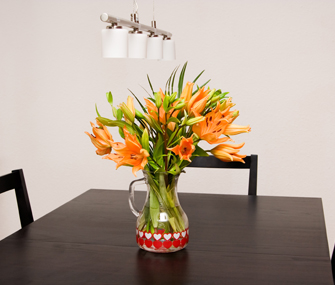 Lillies in a vase on a table