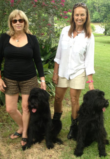 Leslie Sandlin and Barbara Conner of Swamp Dogs of LA pose with their Schnauzers Sissy and Sam