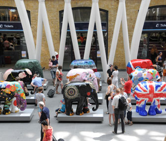 painted elephant statues on display