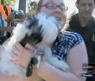 Caitlin Strischek's heartwarming reunion with her dog after a fire was caught on video.