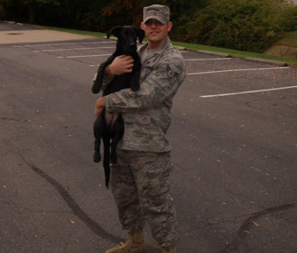 Airman First Class Ronald Simons and and his dog Sanford