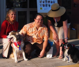 Bentley James, right, officially became the canine mayor of Coronado, California, Wednesday. He's pictured with his vice mayor, Blade, and their families.