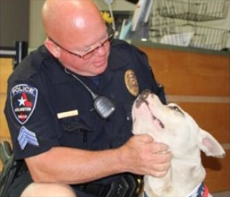 Arlington, Texas, Sgt. Gary Carter has adopted Jeffrey the Pit Bull and named him Chance.