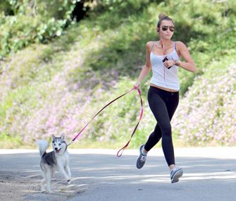 Miley Cyrus jogs with her dog Floyd